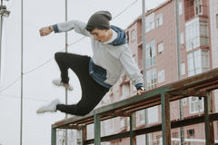Boy in urban parkour royalty free stock photography