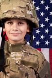 Boy USA soldier in front of American flag. Stock Photography