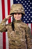 Boy USA soldier saluting in front of American flag. Royalty Free Stock Photos