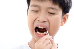 Boy use toothpick. Close up Young asian boy useing toothpick to clean his teeth on white background royalty free stock photo