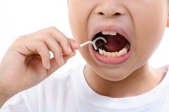 Boy use toothpick Royalty Free Stock Photography