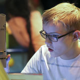 A Boy Uses a Microscope at the Discovery Children`s Museum, Las Stock Photo