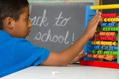 Boy Using Abacus Royalty Free Stock Photo