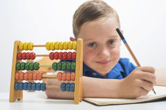 Boy using abacus Royalty Free Stock Photo