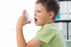 Free Boy Using An Asthma Inhaler Stock Images - 39217994