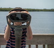 Boy Using Binoculars Stock Images