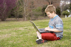 Boy Using a Computer Stock Photo