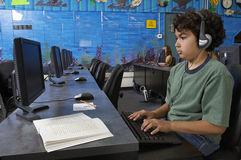 Boy Using Computer Royalty Free Stock Photos