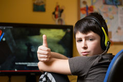 Boy using computer at home, playing game Royalty Free Stock Image