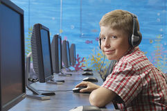 Boy Using Computer In Lab Stock Photo