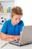 Boy is using computer Royalty Free Stock Images