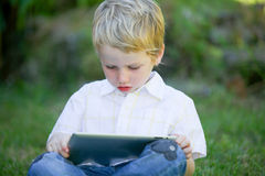 Boy using a computer. Royalty Free Stock Image