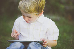 Boy using a computer. Stock Photo