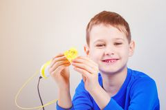Child with 3d printing pen. Creative, technology, leisure, education concept. Boy using 3d pen. Creative, leisure, technology education concept Stock Image