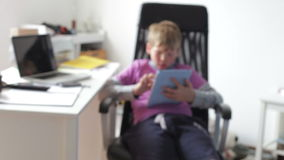 Boy Using Digital Tablet In Bedroom stock video