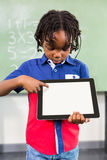 Boy using digital tablet in classroom Stock Images