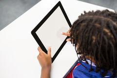 Boy using digital tablet in classroom Stock Photo