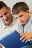 Boy using digital tablet with father Royalty Free Stock Photography