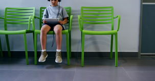 Boy using digital tablet in hospital corridor stock video