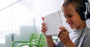 Boy using digital tablet in hospital corridor stock footage