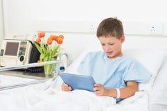 Boy using digital tablet in hospital Stock Image