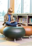 Boy Using Digital Tablet In Library Royalty Free Stock Photo