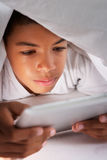 Boy Using Digital Tablet Under Duvet Stock Photos