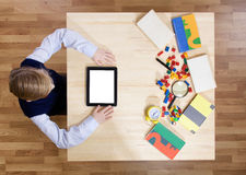 Boy using a digital tablet. View from above Stock Image