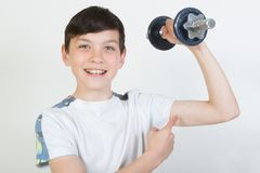 Free Boy Using Dumbbell Weights Stock Photography - 100340662