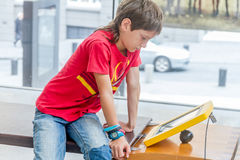 Boy using education interactive touch screen Stock Images