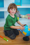 Boy using a globe of the world Royalty Free Stock Images