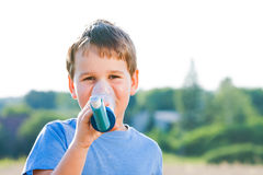 Boy using inhaler for asthma in grain Stock Images