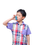 Boy using inhaler for asthma Royalty Free Stock Photos