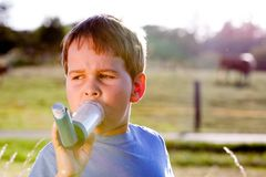 Boy using inhaler for asthma Royalty Free Stock Image