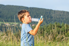Boy using inhaler for asthma Royalty Free Stock Photo
