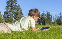 Boy Using iPad Royalty Free Stock Photos
