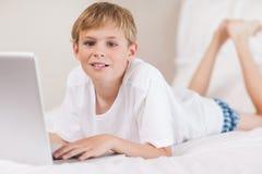 Boy using a laptop Stock Photo