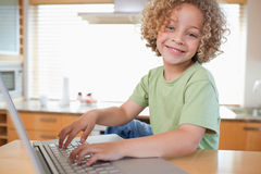 Boy using a laptop Royalty Free Stock Photo