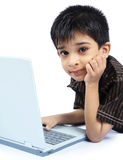 Boy using a laptop. Portrait of Indian Boy using a laptop Royalty Free Stock Photography