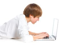 Boy using a laptop Stock Images