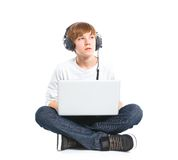 Boy using a laptop. Teenager using a laptop. Isolated on white background Royalty Free Stock Photos