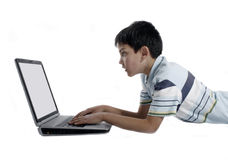 Boy using a laptop Stock Photos