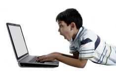 Boy using a laptop Stock Photo