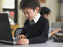 Boy Using Laptop In Class Stock Photography