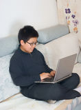 Boy using a laptop computer Royalty Free Stock Photography