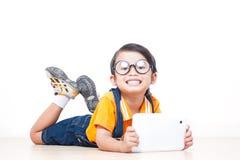 Boy using laptop computer Stock Photos