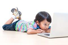 Boy using laptop computer Royalty Free Stock Photos