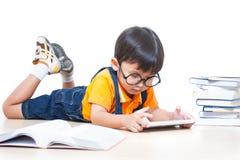 Boy using laptop computer Royalty Free Stock Image