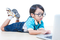 Boy using laptop computer Royalty Free Stock Photography