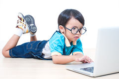 Boy using laptop computer Stock Image